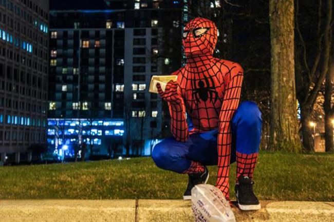 Spiderman feeds homeless at night