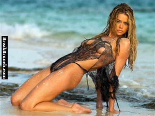 Denise Richards on beach showing bra